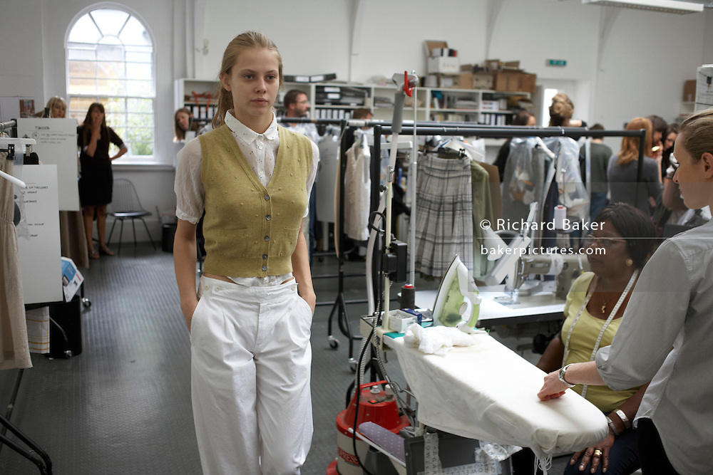 Model shows clothes to staff before couture designer Margaret Howell's Autumn fashion show in her design studio