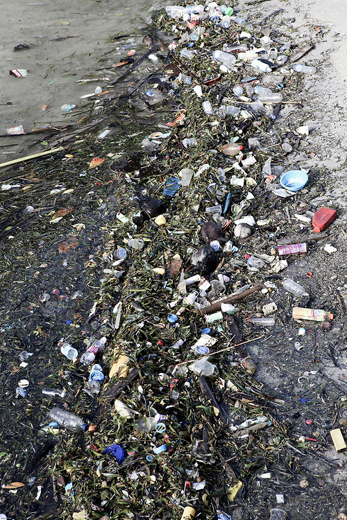 Plastic bags, bottles and other trash polluting beach on Bunaken Island, Sulawesi, Indonesia