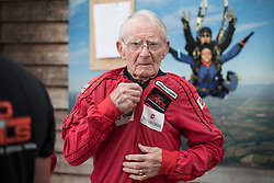 © Licensed to London News Pictures. 25/08/2016. <br /> <br /> Pictured: D-Day Veteran Fred Glover prepares for his parachute jump.<br /> <br /> Fred Glover and Ted Pieri, two D-Day veterans who are both 90 years old have parachuted into Sarum Airfield, Wiltshire on Thursday 25th August 2016, 72 years after D-Day having earlier in the month parachuted into Merville Battery in France.<br /> <br /> Photo credit should read Max Bryan/LNP