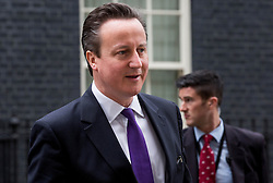 The Prime Minister David Cameron leaves 10 Downing Street for Prime Minister's Questions in there House of Commons, London, United Kingdom. Wednesday, 26th March 2014. Picture by Daniel Leal-Olivas / i-Images