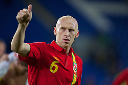 CARDIFF, WALES - Friday, October 11, 2013: Wales' James Collins salutes the supporters as he walks off the pitch following the 1-0 victory over Macedonia during the 2014 FIFA World Cup Brazil Qualifying Group A match at the Cardiff City Stadium. (Pic by David Rawcliffe/Propaganda)