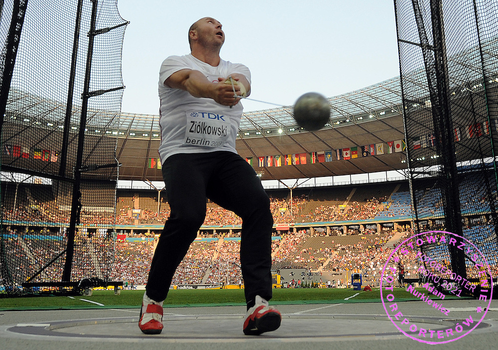 SZYMON ZIOLKOWSKI (POLAND) COMPETES IN HAMMER THROW MEN FINAL ON THE OLYMPIC STADION ( OLIMPIASTADION ) DURING 12TH IAAF WORLD CHAMPIONSHIPS IN ATHLETICS BERLIN 2009.SZYMON ZIOLKOWSKI TOOK THE SILVER MEDAL..BERLIN , GERMANY , AUGUST 17, 2009..( PHOTO BY ADAM NURKIEWICZ / MEDIASPORT )..PICTURE ALSO AVAIBLE IN RAW OR TIFF FORMAT ON SPECIAL REQUEST.