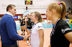 Metod Ropret, president of OZS and Meta Jerala of Calcit Volleyball after winning during match between OK Nova KBM Branik and OK Calcit Volleyball in Finals of Slovenian Women Volleyball Cup 2013/14 on December 27, 2013 in Hoce, Slovenia.  Calcit Volleyball won 3-1 and became Slovenian Cup Champion 2013/14. Photo by Vid Ponikvar / Sportida