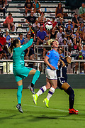 North Carolina Courage goalkeeper Katelyn Rowland (0) makes the save on the header from Manchester City defender Aoife Mannion (2) during an International Champions Cup women's soccer game, Thurday, Aug. 15, 2019, in Cary, NC. The North Carolina Courage defeated Manchester City Women 2-1.  (Brian Villanueva/Image of Sport)