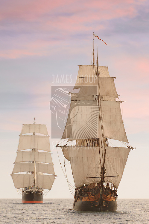 Tall wooden vintage sailing ships shot on the high seas from the front
