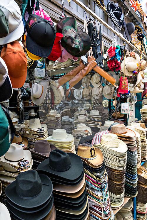 Vendor selling hats Benito Juarez market in Oaxaca, Mexico.
