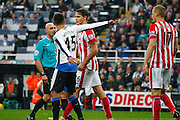 Newcastle United Forward Aleksandar Mitrovic and Stoke City Defender Philipp Wollscheid get heated  during the Barclays Premier League match between Newcastle United and Stoke City at St. James's Park, Newcastle, England on 31 October 2015. Photo by Craig McAllister.