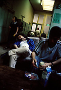 Group lounging around in a communal area of a youth hostel, Amsterdam, Netherlands, 2000's