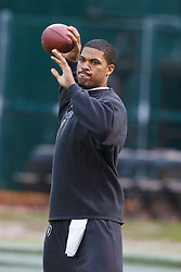 December 19, 2010; Oakland, CA, USA;  Oakland Raiders quarterback Jason Campbell (8) warms up before the game against the Denver Broncos at Oakland-Alameda County Coliseum. Oakland defeated Denver 39-23.