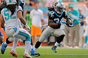 Carolina Panthers running back DeAngelo Williams (34) runs upfield during the Panthers game against the Miami Dolphins at SunLife Stadium on Nov. 24, 2013 in Miami Gardens, Florida. <br /> <br /> ©2013 Scott A. Miller