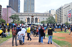 JOHANNESBURG, SOUTH AFRICA – APRIL 07: MKMVA, ANCYL and ANC members gather in Beyers Naude Square near Luthuli House in support of the ANC and Zuma amidst calls for President Zuma to step down, in Johannesburg, South Africa, 07 April 2017. Businesses closed and South Africans from numerous political, religious, labour and civic groups gathered at central points across the entire country protesting against President Zuma's recent government reshuffle appointing 10 new ministers and 10 new deputy ministers including the axing of the finance minister. Photo: Dino Lloyd