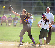 Upper Moreland's Maura Casey #28 catches the ball just after Bishop Shanahan's Marley Weston #10 makes it safely to first base in the fifth inning Friday May 27, 2016 at Upper Moreland High School in Willow Grove, Pennsylvania. (Photo by William Thomas Cain)