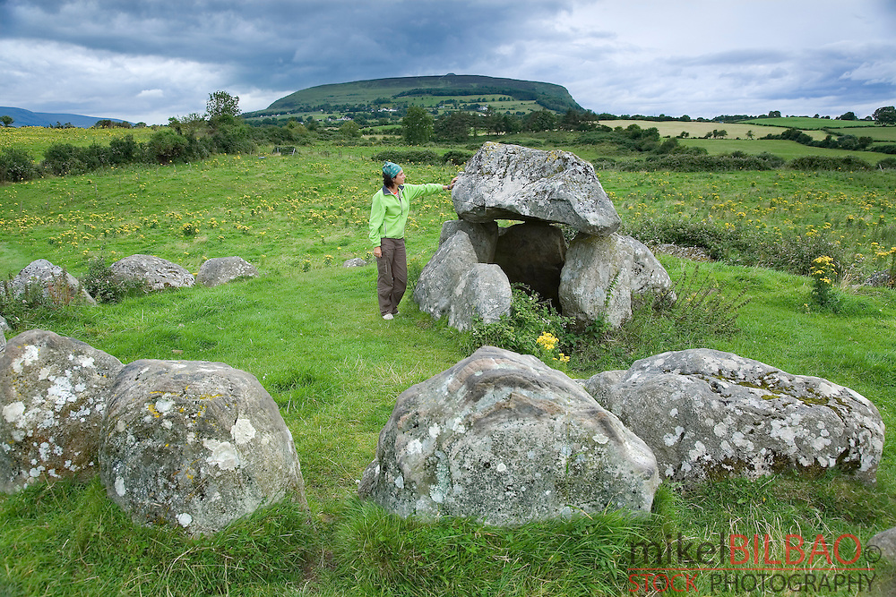 woman in the megalithic tombs. Carrowmore.<br /> Near Sligo city, County Sligo. Republic of Ireland.