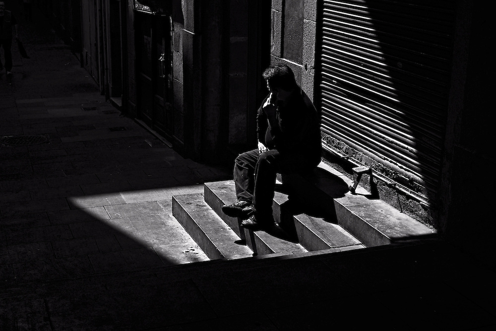 Man sitting on steps outside La Boqueria market
