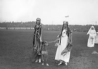"H922 Aonach Tailteann Athletics - Croke Park. Pageant procession. On left ""Queen Tailte"" Miss N. Rock 1928. (Part of the Independent Newspapers Ireland/NLI Collection)"