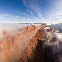 USA, Utah, Moab, Aerial view of cliffs above Colorado River near Arches National Park on winter morning