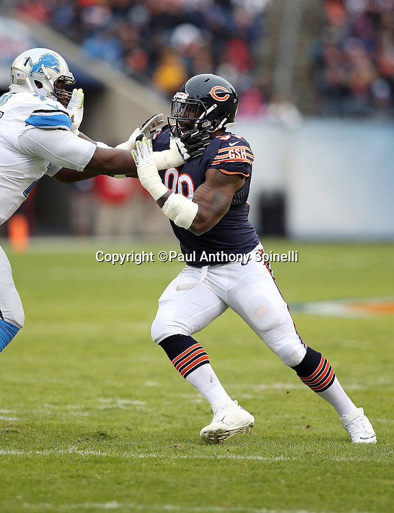 Chicago Bears linebacker Lamarr Houston (99) tries to work his way around a block by Detroit Lions tackle Cornelius Lucas (77) as he chases the action during the NFL week 17 regular season football game against the Detroit Lions on Sunday, Jan. 3, 2016 in Chicago. The Lions won the game 24-20. (©Paul Anthony Spinelli)