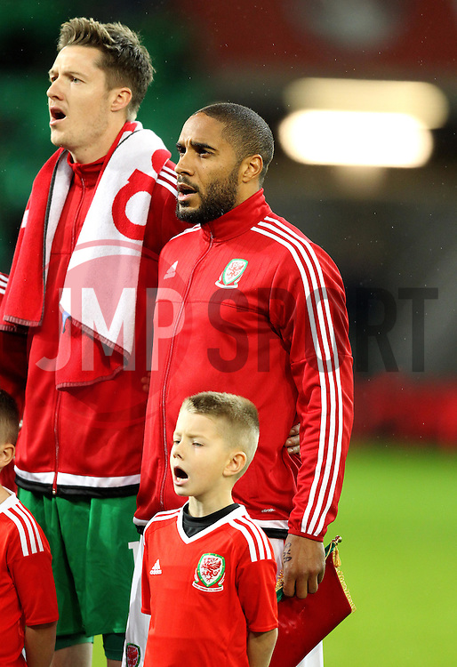 Ashley Williams of Wales, Wayne Hennessey of Wales and a young mascot sing the Welsh national anthem - Mandatory byline: Robbie Stephenson/JMP - 07966 386802 - 13/11/2015 - FOOTBALL - Cardiff City Stadium - Cardiff, Wales - Wales v Netherlands - International Friendly