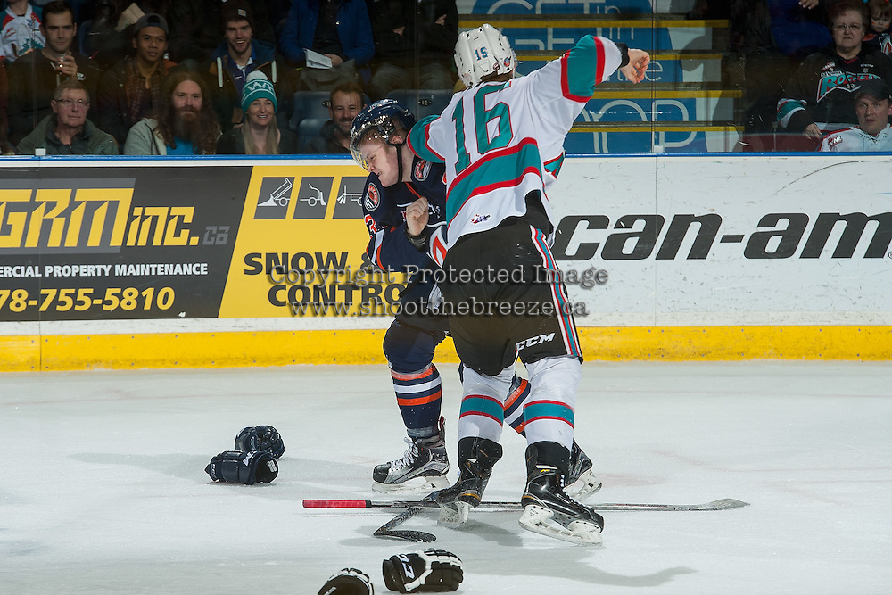 KELOWNA, CANADA - MARCH 11: Kole Lind #16 of Kelowna Rockets drops the gloves with Conner McDonald #33 of Kamloops Blazers on March 11, 2016 at Prospera Place in Kelowna, British Columbia, Canada.  (Photo by Marissa Baecker/Shoot the Breeze)  *** Local Caption *** Conner McDonald; Kole Lind;