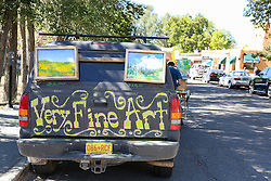 car with artwork attached to it in Taos, NM