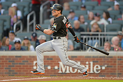 May 18, 2018 - Atlanta, GA, U.S. - ATLANTA, GA Ð MAY 18:  Marlins outfielder Derek Dietrich (32) drives a pitch to the outfield during the game between Atlanta and Miami on May 18th, 2018 at SunTrust Park in Atlanta, GA. (Photo by Rich von Biberstein/Icon Sportswire) (Credit Image: © Rich Von Biberstein/Icon SMI via ZUMA Press)