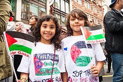 London, July 11th 2014. Two little girls add their message as thousands of Palestinians and their supporters demonstrate against the latest wave of Israeli retaliatory attacks on Palestinian targets and homes, where casualties are steadily mounting.