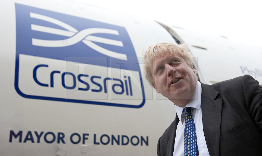© licensed to London News Pictures. London, UK 13/03/2012. Mayor of London, Boris Johnson is posing in front of Crossrail tunnel boring machines as machines started to work for the first time in Westbourne Park this morning. Photo credit: Tolga Akmen/LNP