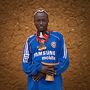 The football stars of tomorrow<br /> <br /> Thousands of Football shirts of Arsenal, Manchester, Chelsea, Milano, etc end up their carreer in... Ethiopia. Sold in the deep south, in the Omo Valley, those second hand clothes are bought by the local tribes. Most of them ignore the meaning of those shirts, and just buy them for the color, the logo, or the shape.<br /> No warrior will go out without his little pillow/seat.<br /> Some, like in Hamer tribe wear at the top of the head a clay helmet where they can put some ostrich feathers when they make a special action, like killing a wild animal, or...a man.<br /> Those tribes won&rsquo;t exist in few years as the ethiopian governement has launched a huge plan to develop the area.<br /> Soon, a highway coming from Mombassa - Nairobi will pass thru the villages to reach Addis Ababa.<br /> <br /> Photo shows: Hamar in Turmi, Ethiopia. He wears a Chelsea shirt because all the men who can access to a Tv in villages love football!<br /> &copy;Eric Lafforgue/Exclusivepix Media