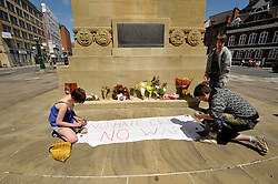 © Licensed to London News Pictures. 01/06/2013. Bristol, UK.  Flowers and signs are laid at the Cenotaph in Bristol city centre, in memory of soldier Lee Rigby, who was murdered in Woolwich in May 2013.  It was rumoured that the English Defence League would attend but no one admitted to being a member of the EDL.  Anti-fascist protestors gathered close by. 01 June 2013.<br /> Photo credit : Simon Chapman/LNP