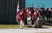 Volunteer actors dressed as British military troops re-enact the arrival of the British to take control of Fort Michilimackinac from French troops during the Fort Michilimackinac Pageant that is part of the Memorial Weekend celebrations in Mackinaw City, Michigan.