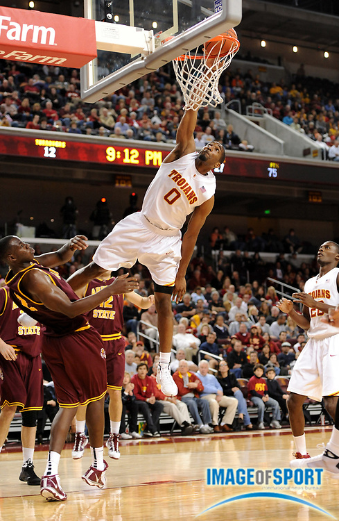 Jan 2, 2010; Los Angeles, CA, USA; Southern California Trojans forward Marcus Johnson (0) goes up for a dunk as Arizona State Sun Devils center Eric Boateng (2) defends at the Galen Center. USC defeated Arizona State 47-37.