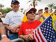 22 OCTOBER 2010 - PHOENIX, AZ:  People pray at the beginning of a Tea Party rally in Phoenix, AZ, Friday. About 300 people attended a Tea Party rally on the lawn of the Arizona State Capitol in Phoenix Friday. They demanded lower taxes, less government spending, repeal of the health care reform bill, and strengthening of the US side of the US - Mexican border. They listened to Arizona politicians and applauded wildly when former Alaska Governor Sarah Palin and her son, Trig, made a surprise appearance. The event was a part of the Tea Party Express bus tour that is crossing the United States.     Photo by Jack Kurtz