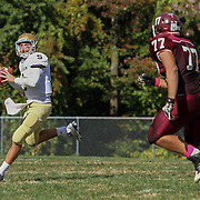 Salesianum quarterback Garrett Cannon (6) attempts to throw a pass while scrambling outside of the pocket in the second quarter Saturday, Oct. 17, 2015 at Concord Stadium in Wilmington.