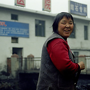 Many women work in coal mining. They work in overground mining. Wanghazhai, South West China