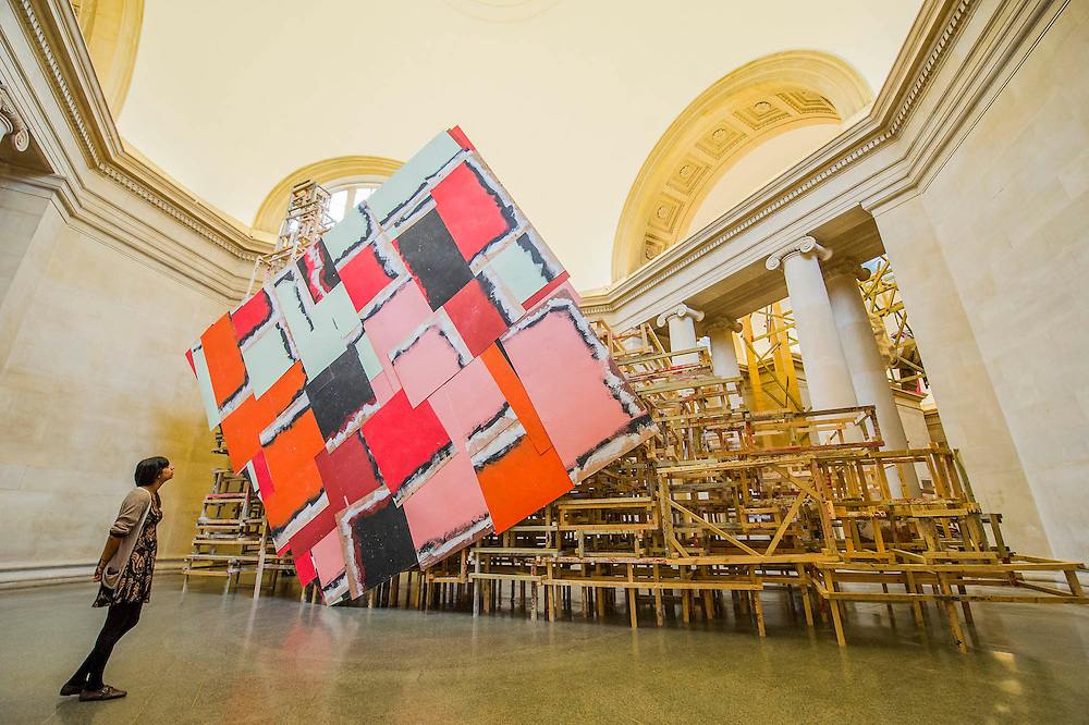 Phyllida Barlow's new work 'dock' is the new installation, which fills Tate Britain's Duveen Galleries. Here untitled:dock:huge container. It has been created as part of the annual Tate Britain Commission, in which a leading contemporary artist is invited to develop a work inspired by Tate's Collection. Phyllida Barlow has worked for over four decades with inexpensive, everyday materials to create large sculptural installations and bold and colourful three-dimensional collages. Tate Britain, Millbank, London, UK 31 March 2014.   Guy Bell Photography, 07771 786236, guy@gbphotos.com