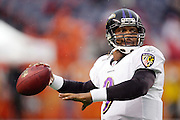 DENVER - OCTOBER 9:  Quarterback Steve McNair #9 of the Baltimore Ravens unloads a pass during pregame warmups against the Denver Broncos at INVESCO Field at Mile High on October 9, 2006 in Denver, Colorado. The Broncos defeated the Ravens 13-3. ©Paul Anthony Spinelli *** Local Caption *** Steve McNair