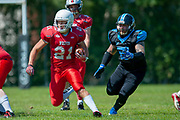 Calum Davidson (#21) outruns Giants Jack Ramsden (#19) during the BAFA Northern Division match between Edinburgh Wolves and Sheffield Giants at Meggetland Sports Complex, Edinburgh, Scotland on 1 July 2018. Picture by Malcolm Mackenzie.