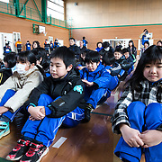 OGA, JAPAN - MARCH 17: Students at the Hokuyou Elementary School move inside of a gym during a missile evacuation drill on Friday, March 17, 2017, in Kitaura, Oga, Akita Prefecture, Japan. During the drill, around 50 kids were instructed to walk slowly inside of a school gym, as if a missile had hit the the ground nearby. After a loud siren, people are instructed through a loudspeaker to move to safer ground in the school. People participated in the first missile evacuation drill organized by the Akita prefectural office and Oga city to prepare people in the event of a North Korean Missile strike on Japan. Recently, Three of four missiles fired by North Korea may have fallen into Japan's Exclusive Economic Zone and the Japanese government has lodged a strong protest against North Korea. (Photo: Richard Atrero de Guzman/ANADOLU Agency)