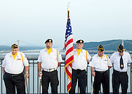 Highland, New York - A color guard of VFW and American Legion members with the American Flag during a Memorial Day ceremony at the center of the Walkway over the Hudson on May 27, 2012.  The Mid-Hudson Bridge over the Hudson River is in the background.