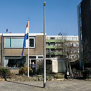 "Nederland Utrecht 31 januari 2009 20090131 Foto: David Rozing ..Serie vogelaarwijk Kanaleneiland .Reportage documentary on deprived area / projects "" Kanaleneiland "" This area is on a list with projects which need help of the government because of degradation in the area etc.Autochtone man in deuropening woning in overwegend allochtone wijk, in zijn voortuin staat een reusachtige vlag vlaggenmast met nederlands vlag, vaderland, vaderlandslievend, nationalistisch, nationalistische. .Man in front of house withe huge dutch flag in his garden, patriotic..project, suburb, suburbian, problem. Neighboorhood, neighboorhoods, district, city, problems, multicultural, cultural diversity, daily lifeFoto: David Rozing"