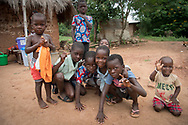Children gather for a photograph as while volunteers with Ghanaian Mothers' Hope work in a small fishing village on the Volta River, near Akosombo, Ghana, Thursday, July 27, 2017. Ghanaian Mothers' Hope is a US based non-profit working to bring clean water, education, and healthcare to Ghanaian Villages in need.
