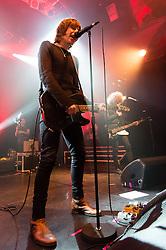© Licensed to London News Pictures. 07/11/2014. London, UK.   Catfish and the Bottlemen performing live at KOKO .   In this picture - Ryan Van McCann (left), Benji Blakeway (right).  Catfish and the Battlement are composed of members Ryan Van McCann (Lead vocals, Rhythm guitar), Johnny 'Bondy' Bond (Lead Guitar), Benji Blakeway (Bass Guitar), Bob Hall – (Drums).  Photo credit : Richard Isaac/LNP