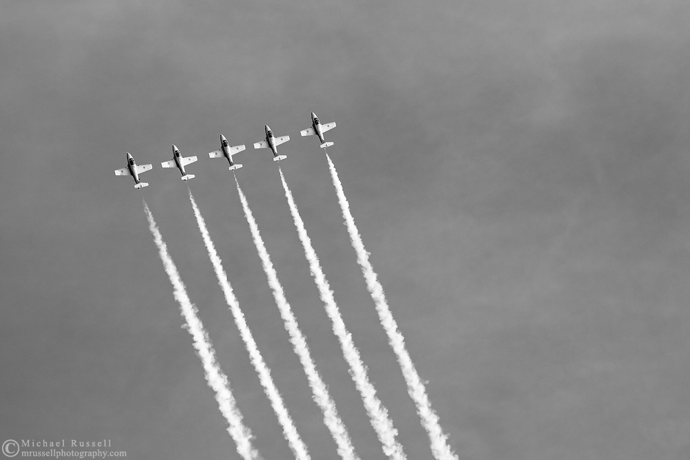 Canadian Forces Snowbirds starting a loop in the Five Line Abreast formation with smoke.  The Snowbirds are also known as the 431 Air Demonstration Squadron and fly the Canadair CT-114 Tutor jet. Photographed during the Canada 150 celebrations in White Rock, British Columbia, Canada.