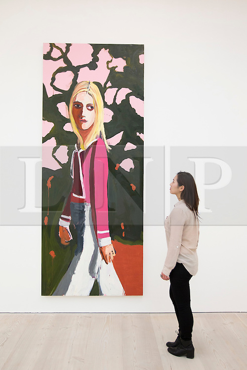 © Licensed to London News Pictures. 19/11/2013. London, UK. A Saatchi Gallery employee views 'Woman with Flowers' (2004), by American artist Chantal Joffe, at the press view for 'Body Language' a new exhibition at the gallery in London today (19/11/2013). Focussing on the human form, the exhibition features the work of 19 emerging international artists and opens to the public on the 20th of November 2013. Photo credit: Matt Cetti-Roberts/LNP