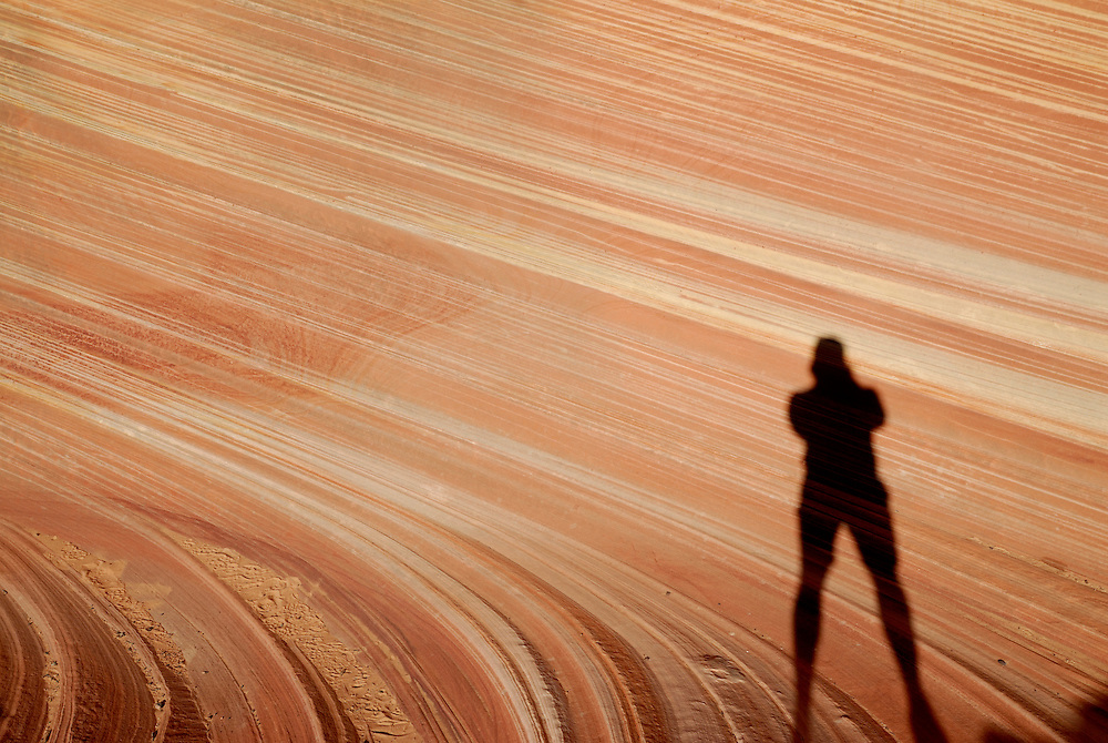 """Silhouette of am man standing in the beautiful rock formation """"The wave"""", Vermillion Cliffs, Utah, USA"""