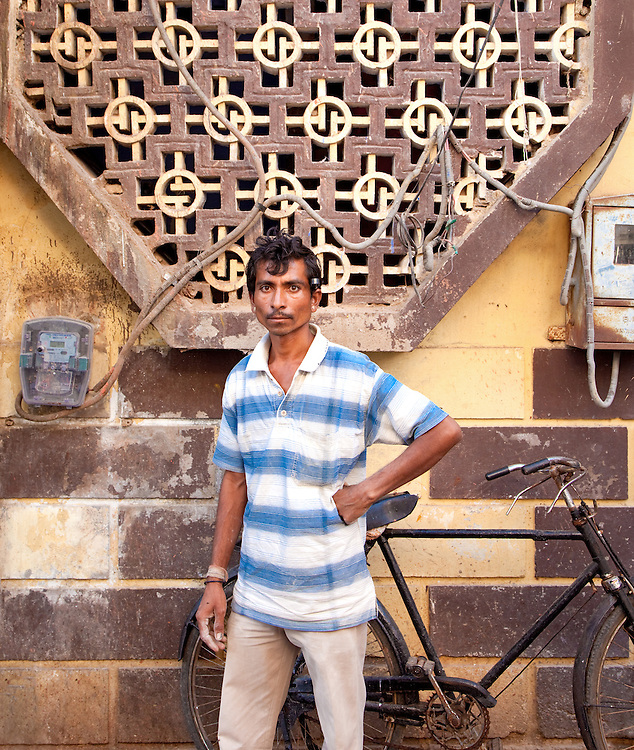 A Cement Worker Poses By His Bicycle In Jodphur, Rajasthan, India