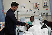 AFC Wimbledon attacker Egli Kaja (21) delivering Christmas presents to the children on behalf of AFC Wimbledon, at St George's Hospital, Tooting, United Kingdom on 13 December 2018.