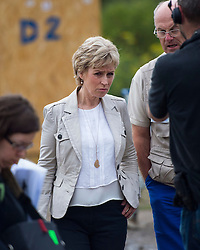 © London News Pictures. 10/08/2015. Calais, France. Presenter SALLY MAGNUSSON (blonde hair and light jacket) taking part in Filming for BBC songs of Praise taking place in the migrants camp in Calais, France,  known as 'The Jungle'. The filming centred around a makeshift church built within the migrant camp. Songs of Praise is a religious BBC Television programme. Photo credit: Ben Cawthra/LNP