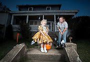 Four-year-old Rosie Spencer, second attendant at the Chauncey Dover Spring Festival, throws a tamper tantrum after her mother, Tara, tells her that she has to sit on a pumpkin for part of a portrait session, on Wednesday evening, Oct. 7, 2009, in front of their Glouster, Ohio, home.