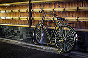 A bicycle rests againsta a bamboo wall in one of the back streets of Kyoto